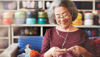 Women knitting with pink wool